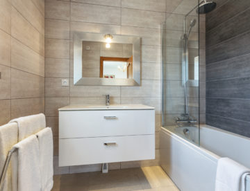 Modern bathroom shower room with toilet and amenities